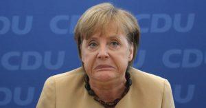 Меркель обвиняют в злоупотреблении служебным положением